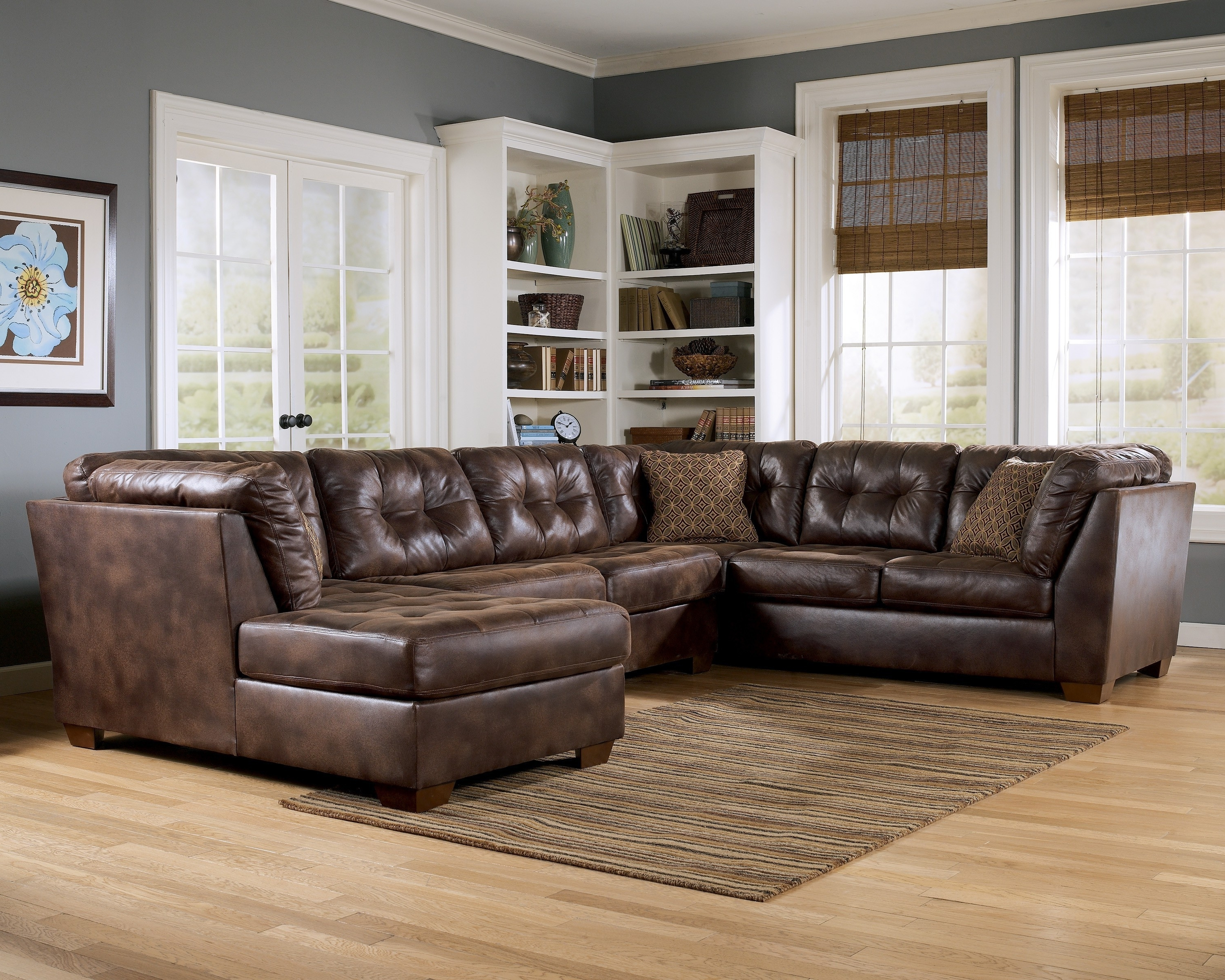 Leather Lounge Sofas Inside Fashionable L Black Leather Chaise Lounge Sofa With Back And Brown Cushions (View 5 of 20)