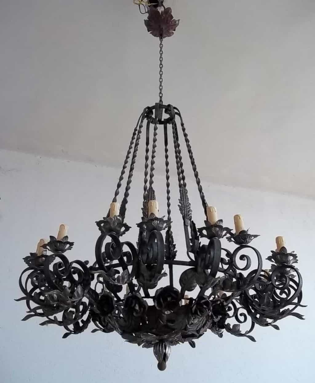 Newest Wrought Iron Chandelier Intended For Black Vintage Wrought Iron Chandelier Hung In The White Ceiling (View 4 of 20)