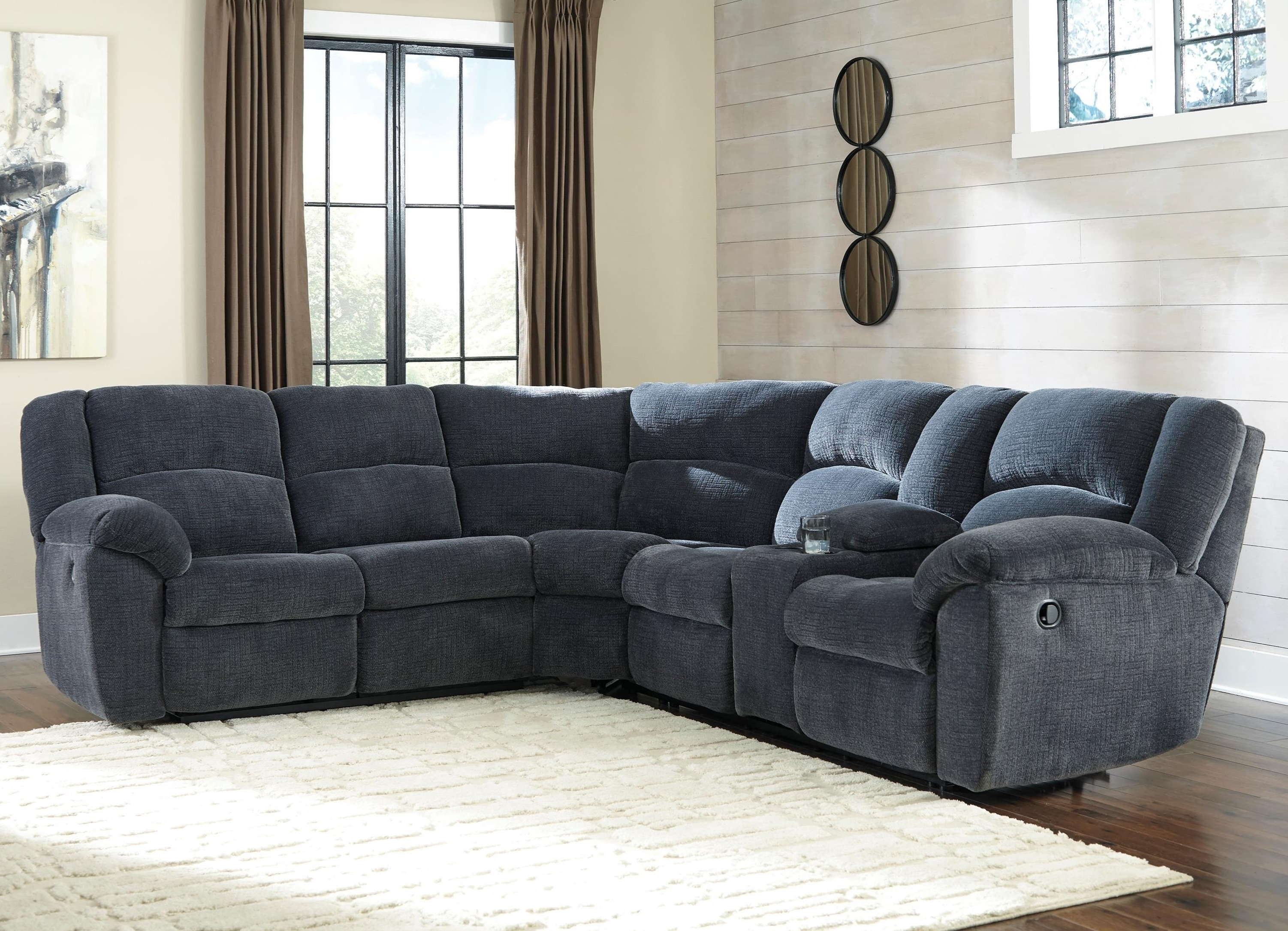 Reclining Sectional Sofas With Fashionable Benchcraft Timpson Reclining Sectional With Storage Console (View 16 of 20)