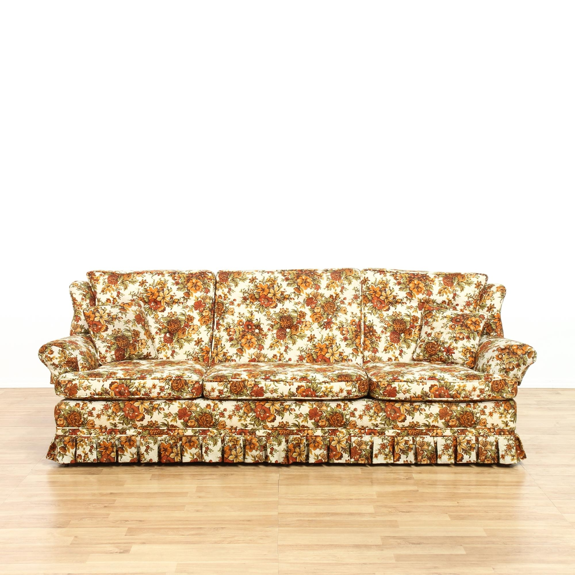 This Sofa Is Upholstered In An Orange Floral Pattern (View 16 of 20)