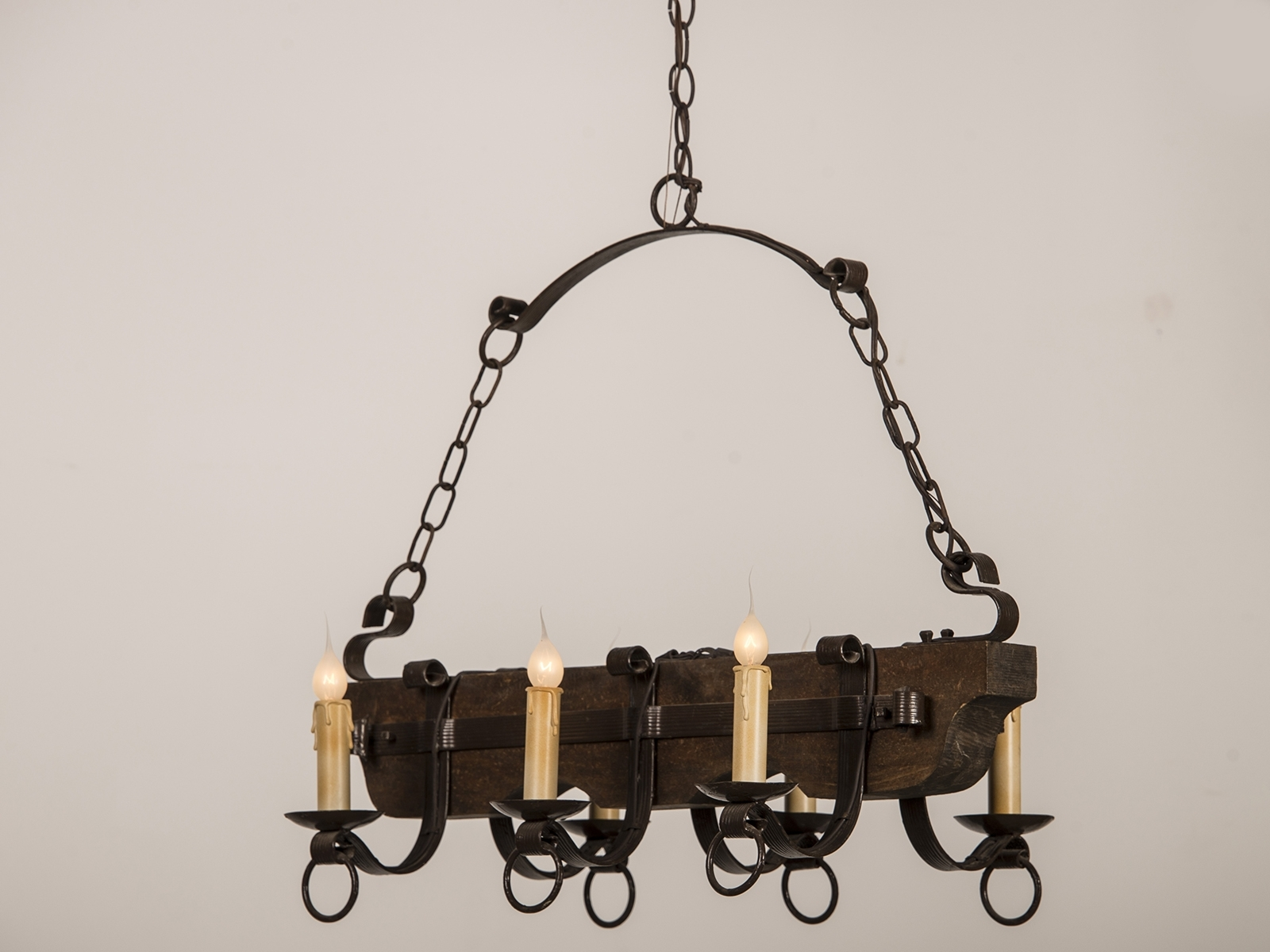 Vintage Wrought Iron Chandelier Regarding Well Known Old And Vintage Wood And Black Iron Chandelier With Candle Holder (View 14 of 20)