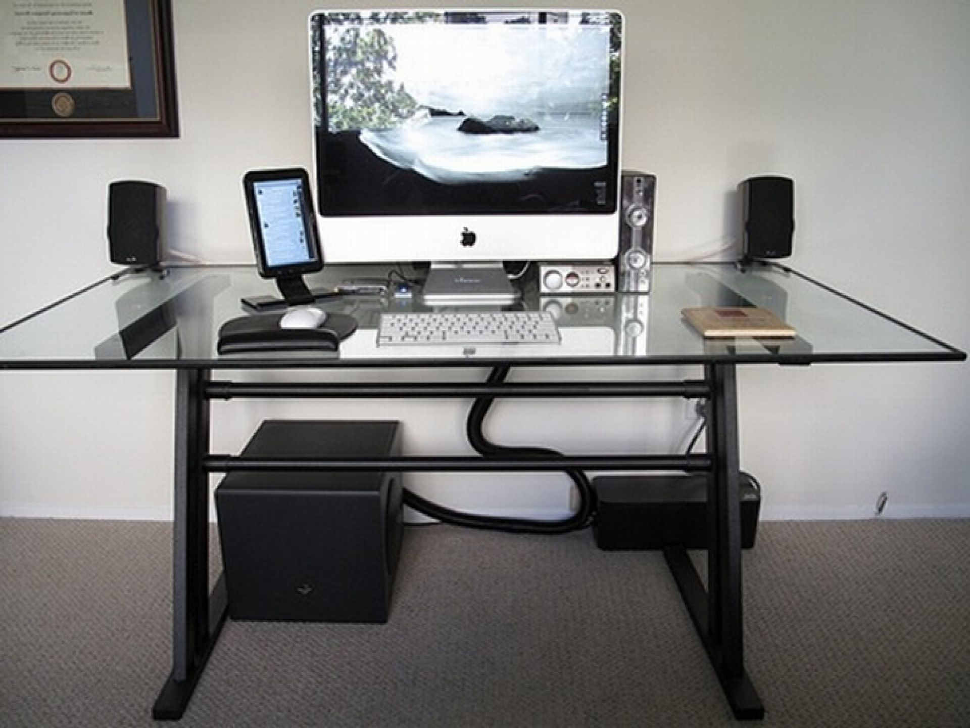 Well Known Modern Computer Desk With Glass Top And Black Legs On Grey Carpet Within Modern Computer Desks (View 19 of 20)