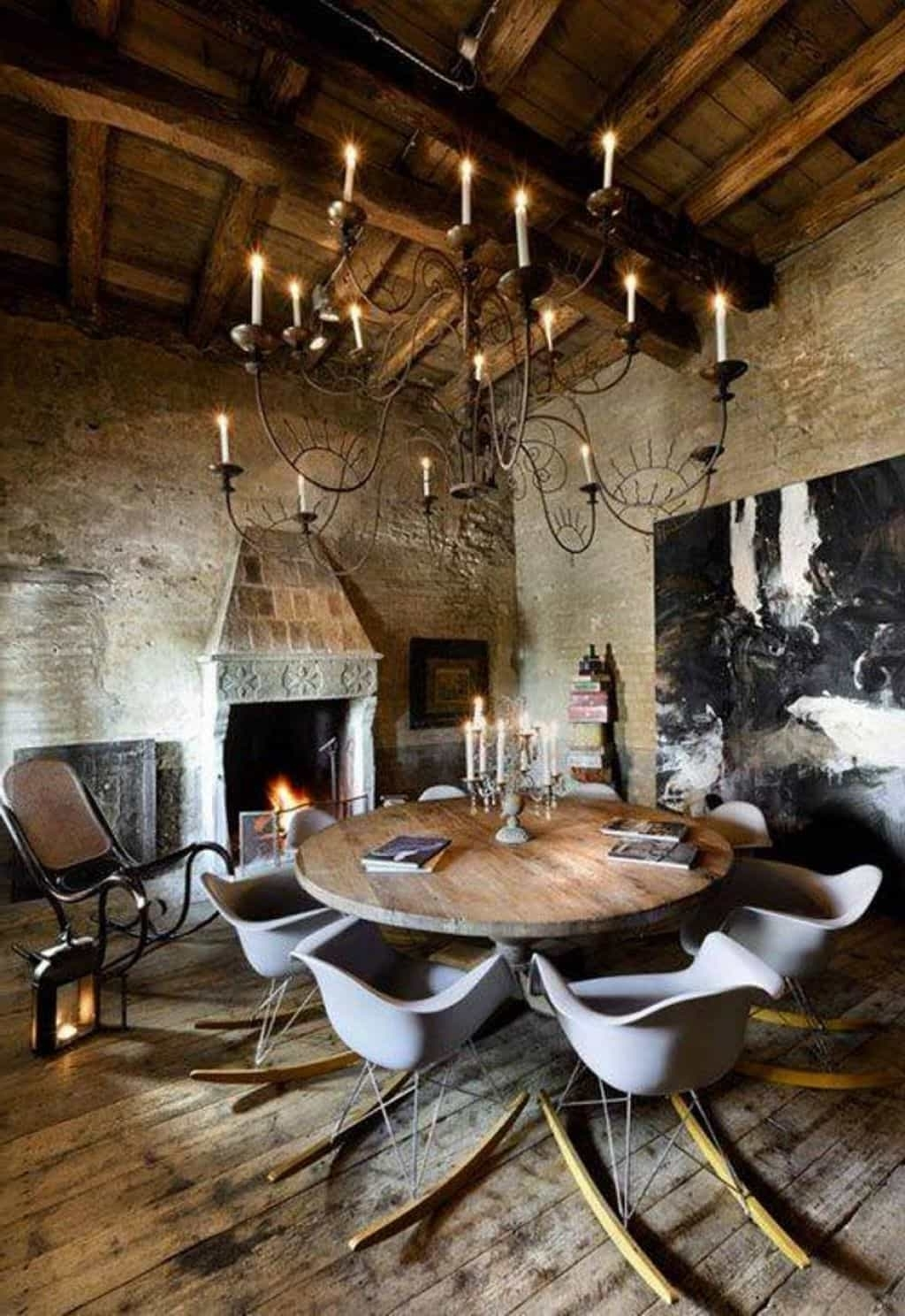 2019 Rustic Dining Room With Large Wrought Iron Chandelier Over Round Pertaining To Large Iron Chandeliers (View 3 of 20)