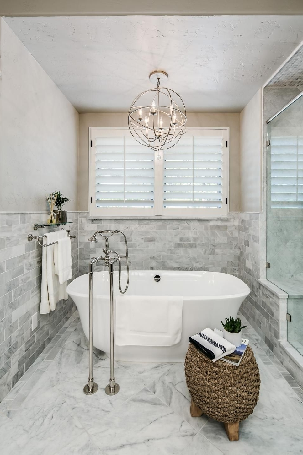 Bathroom Safe Chandeliers Within Most Current A Metal Orb Chandelier Is Centered Above The Freestanding Tub In (View 10 of 20)