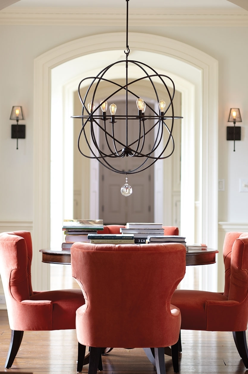 Oversized Chandeliers With Well Known Black Color Metal Oversized Chandeliers Above Round Wooden Table And (View 20 of 20)