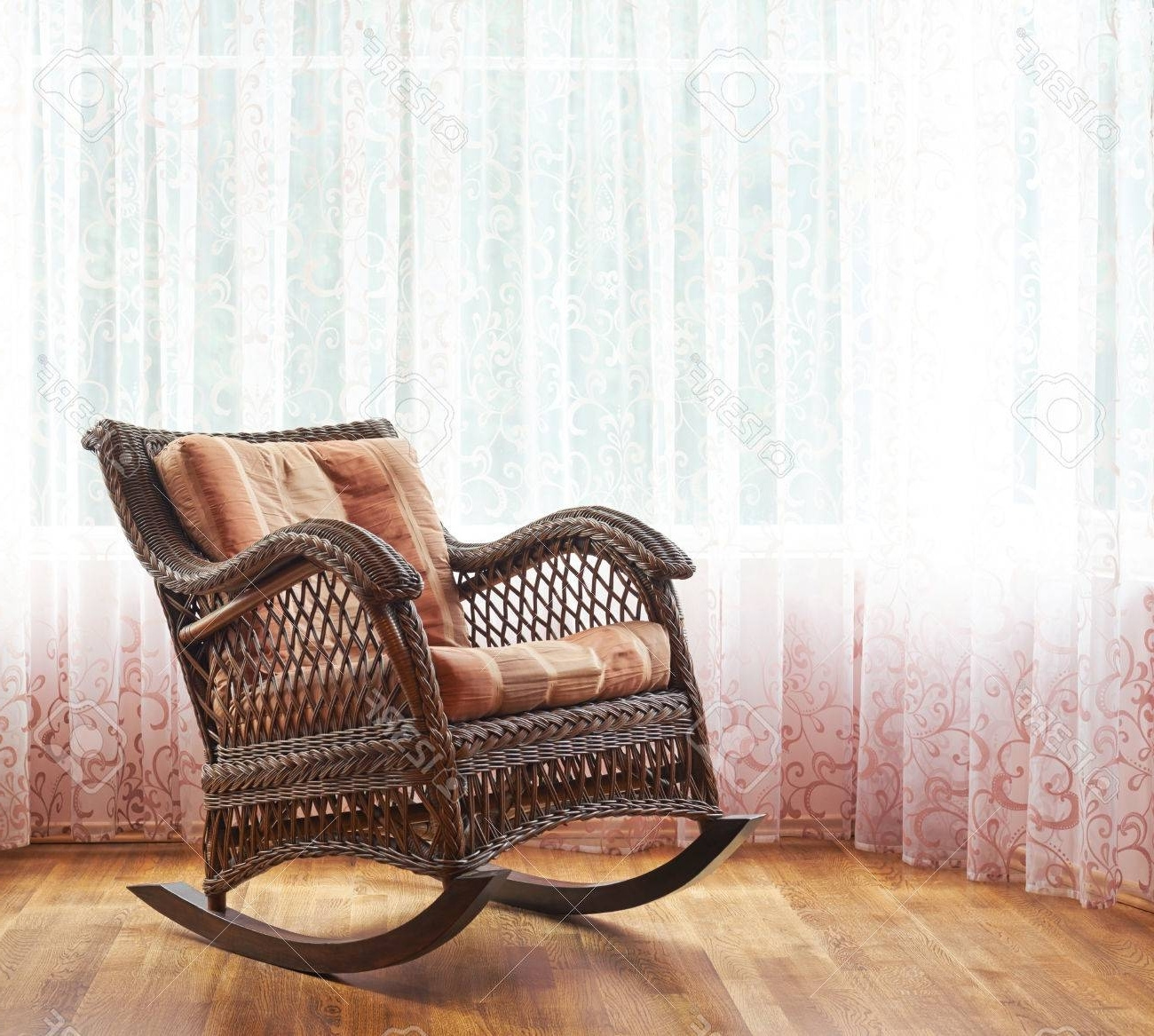 Brown Wicker Rocking Chair Against The Window's Curtains, Indoor Regarding Most Current Indoor Wicker Rocking Chairs (View 5 of 20)