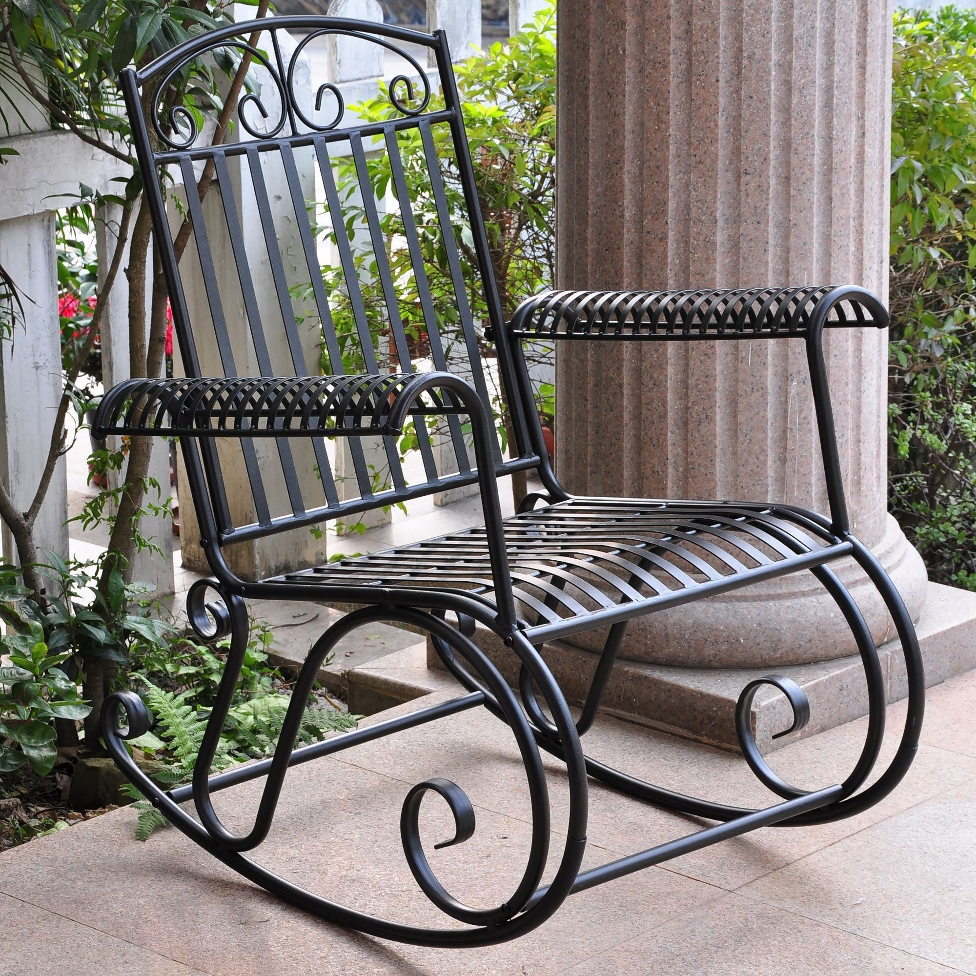 Current Wrought Iron Patio Rocking Chairs For Wrought Iron Chairs With Upholstered Cushions At An Outdoor Seating (View 5 of 20)