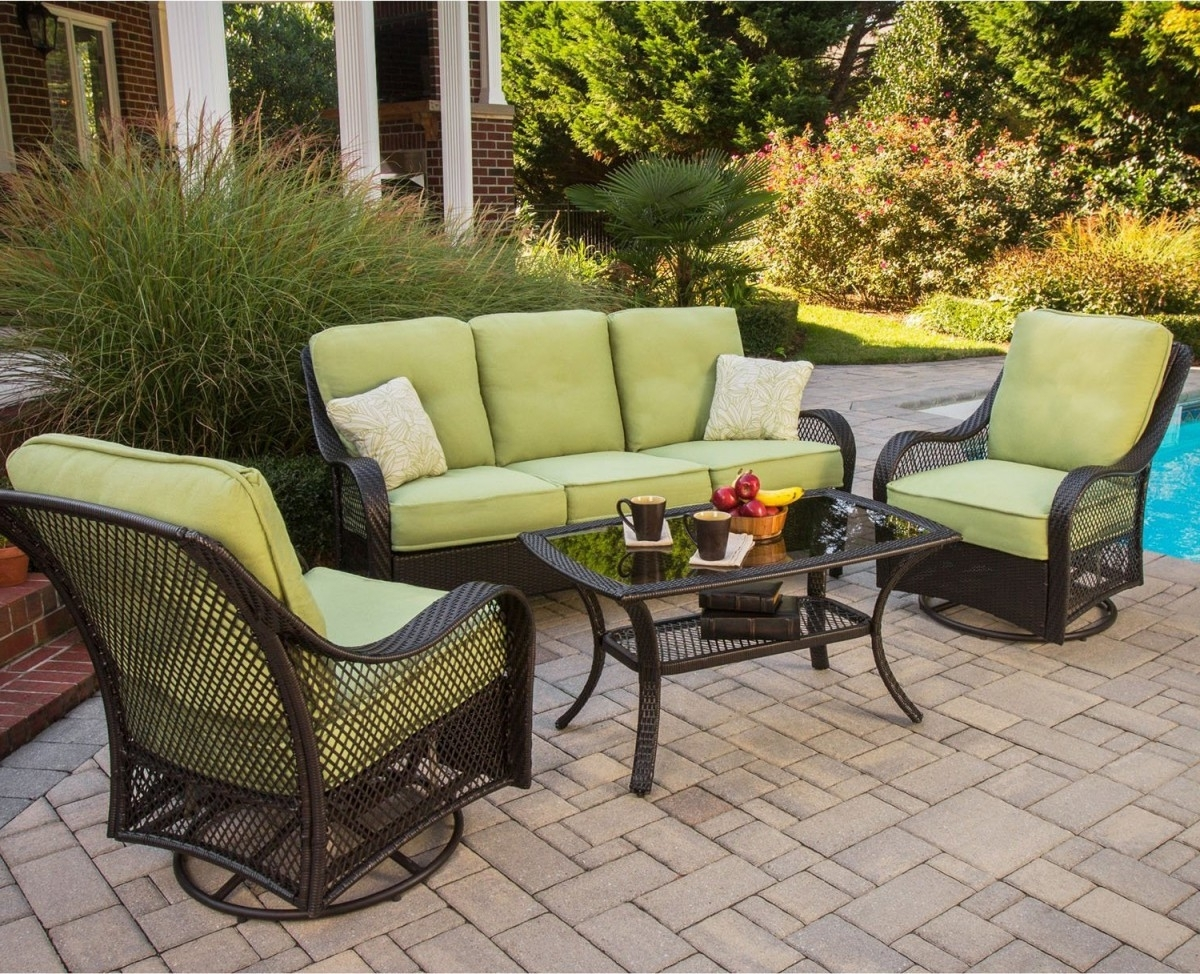 Patio Conversation Sets With Glider In Fashionable Hanover Orleans 4 Piece Outdoor Conversation Set With Swivel Glider (View 9 of 20)
