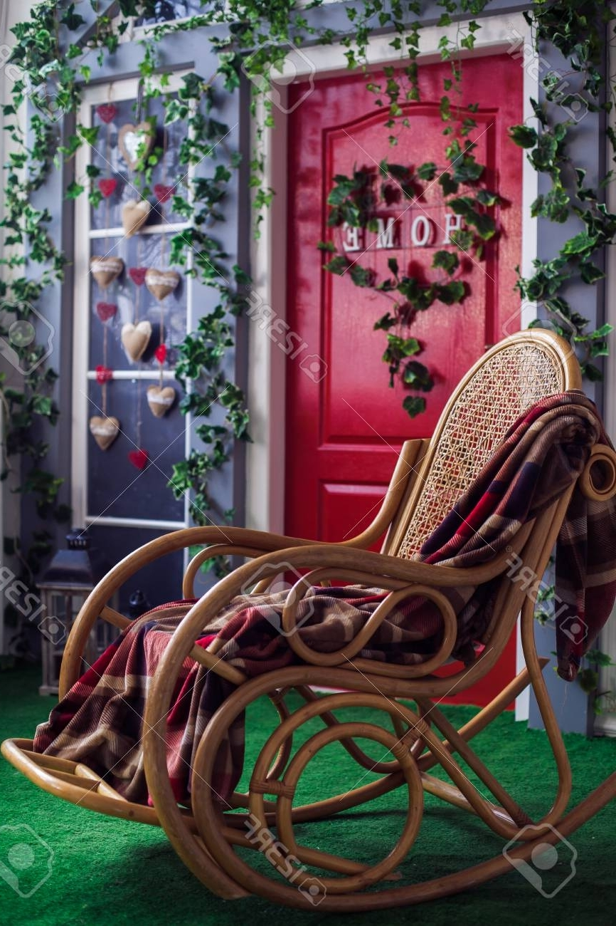 Widely Used Wicker Rocking Chair At The Spring Patio With Green Grace Lawn Regarding Red Patio Rocking Chairs (View 19 of 20)