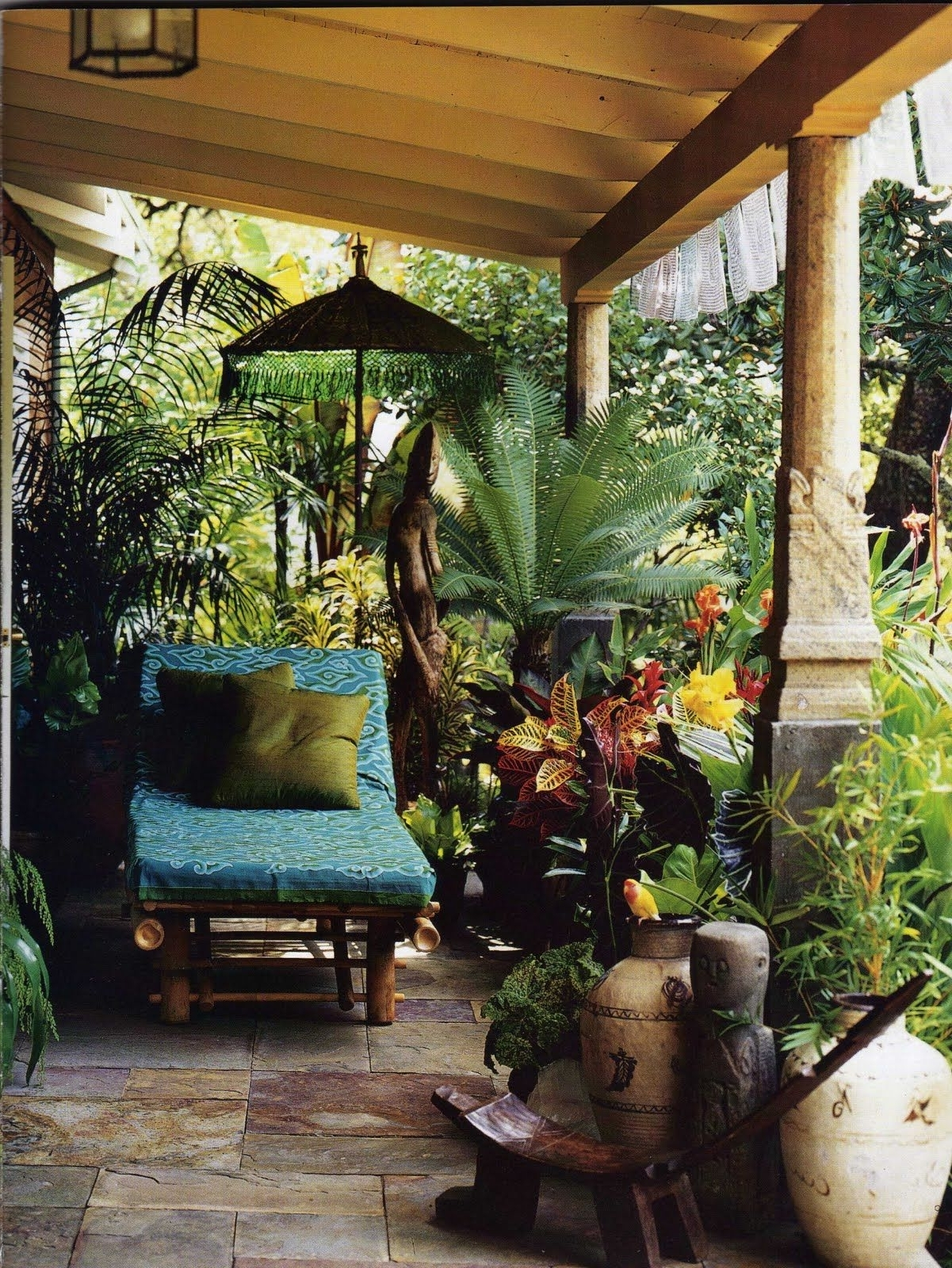 Bursting With Tropical Plants, Art, Sculpture, Umbrellas, And Inside Popular Exotic Patio Umbrellas (View 4 of 20)