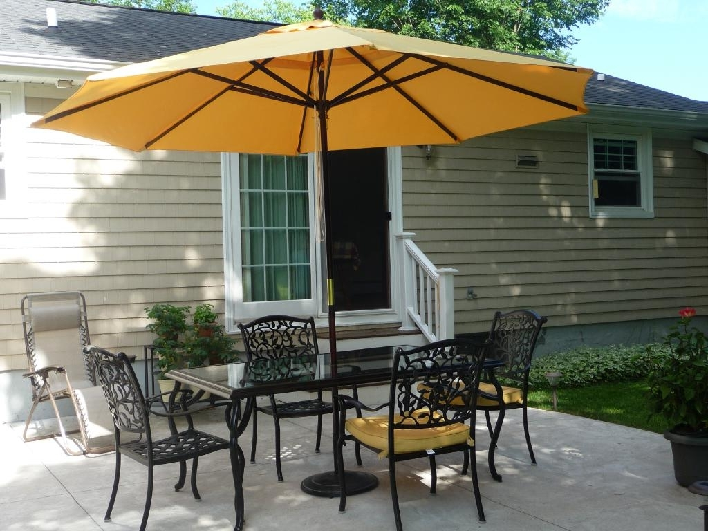 Contemporary Patio Ideas With Dark Brown Painted Wooden Yellow Pertaining To Best And Newest Yellow Sunbrella Patio Umbrellas (View 3 of 20)