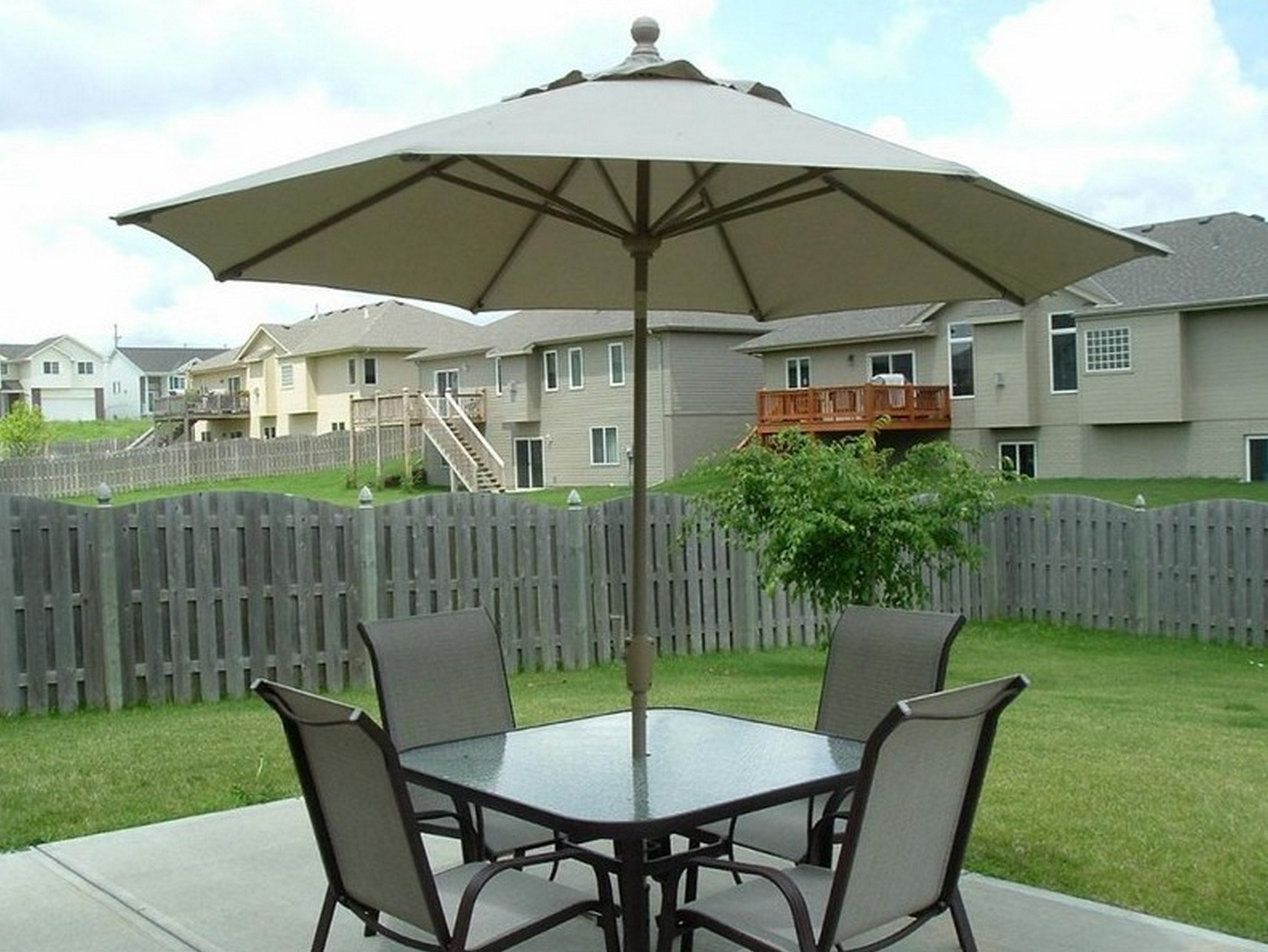 Featured Photo of Patio Table And Chairs With Umbrellas