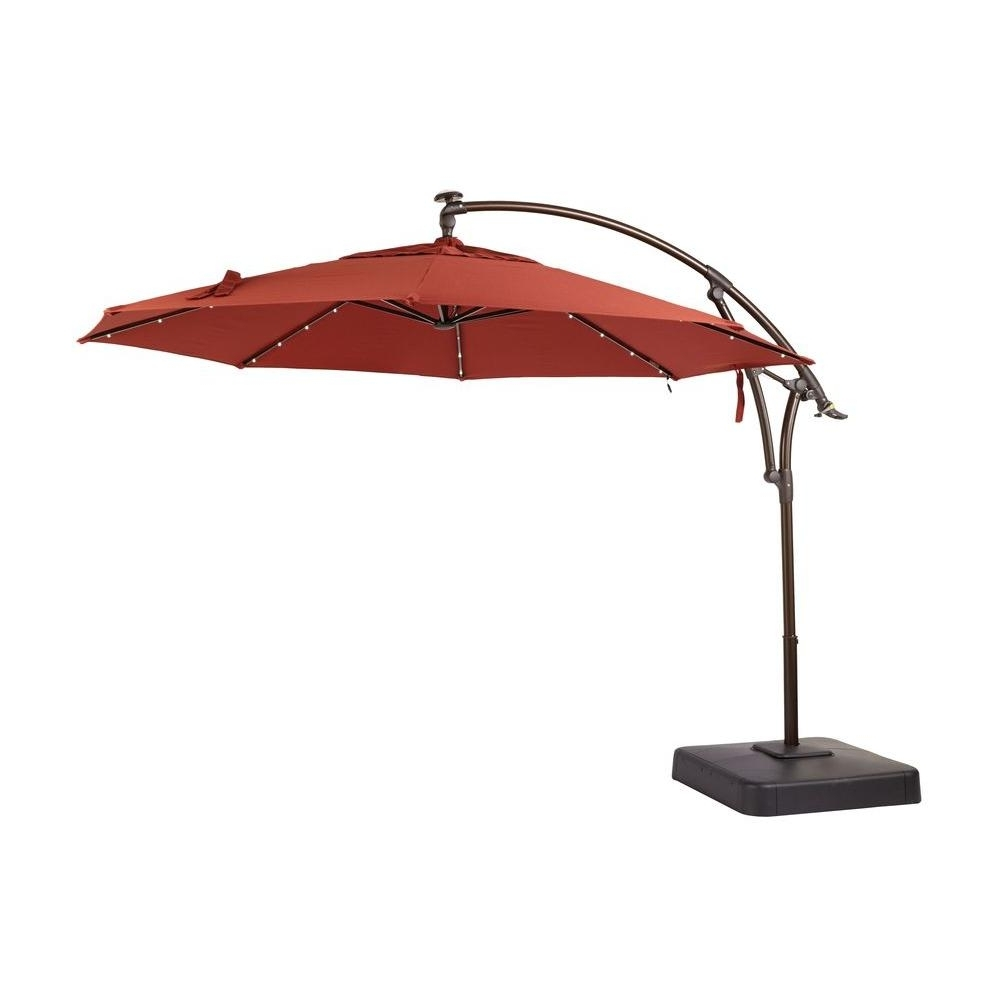 Hampton Bay 11 Ft. Led Offset Patio Umbrella In Sunbrella Henna With Trendy Sunbrella Patio Umbrella With Lights (Gallery 1 of 20)