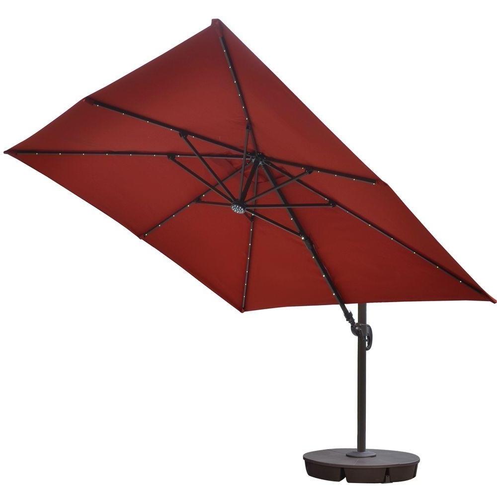 Island Umbrella Santorini Ii Fiesta 10 Ft. Square Cantilever Solar Throughout Most Popular Sunbrella Patio Umbrellas With Solar Lights (Gallery 15 of 20)