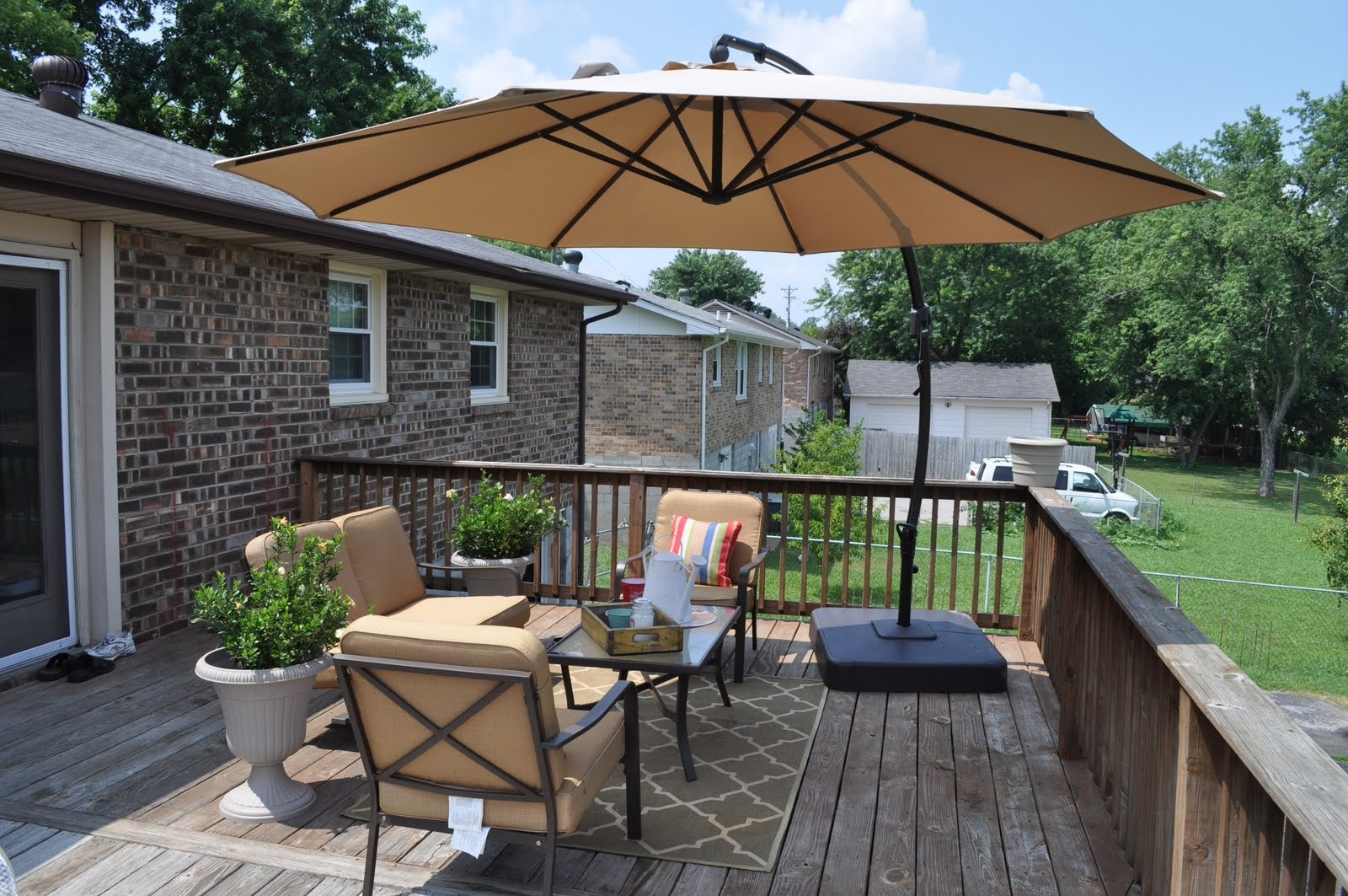 Latest Decorating Patio Furniture With Umbrella — Life On The Move Intended For Patio Deck Umbrellas (View 8 of 20)