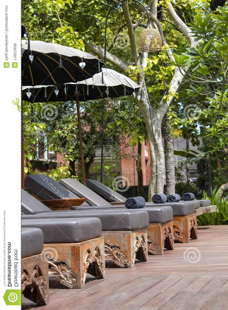 Most Current Exotic Patio Umbrellas Regarding Deck Chairs And Umbrellas In Tropical Garden Near Swimming Pool On (View 13 of 20)