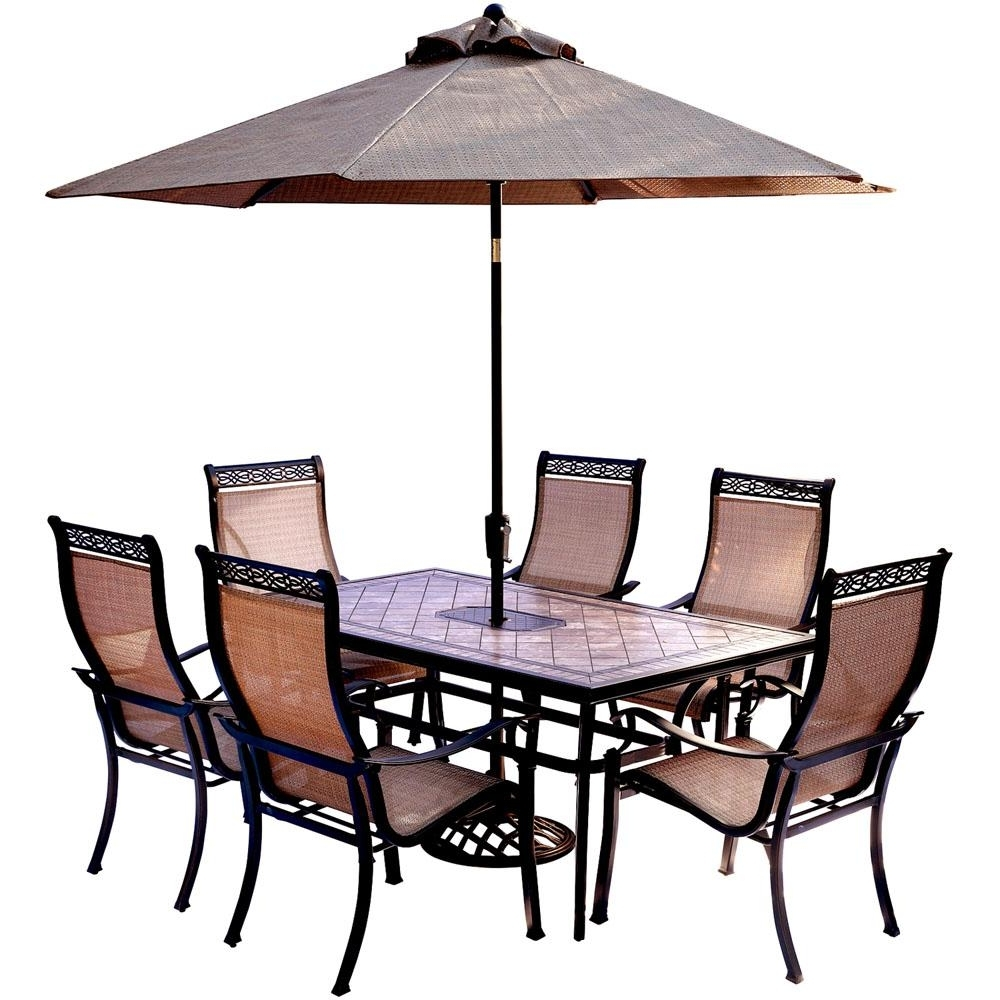 Patio Table And Chairs With Umbrellas With Regard To Favorite Hanover 7 Piece Outdoor Dining Set With Rectangular Tile Top Table (View 14 of 20)