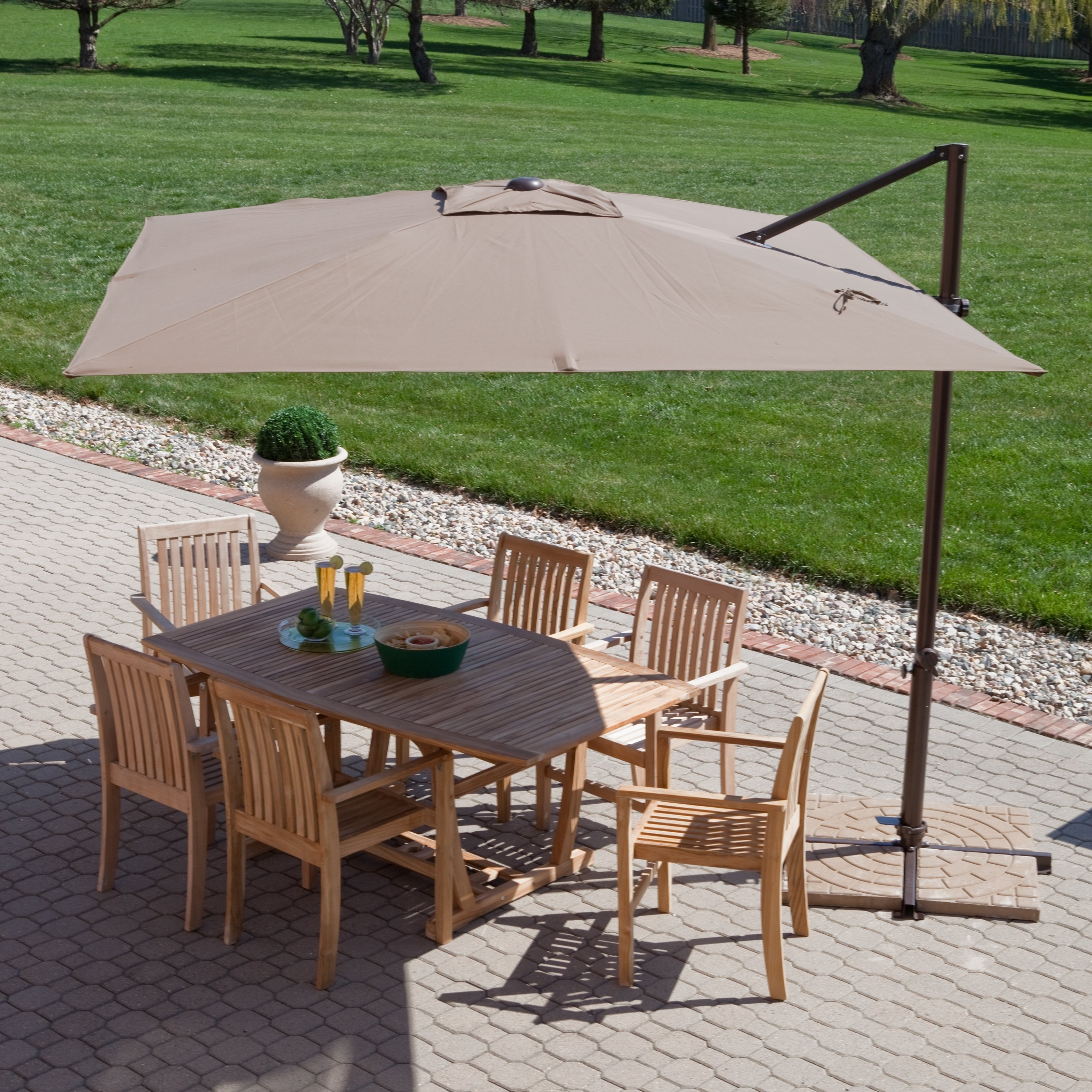 Square Mocha Fabric Patio Umbrella With Black Metal Base Over Brown Within Fashionable Offset Rectangular Patio Umbrellas (View 11 of 20)