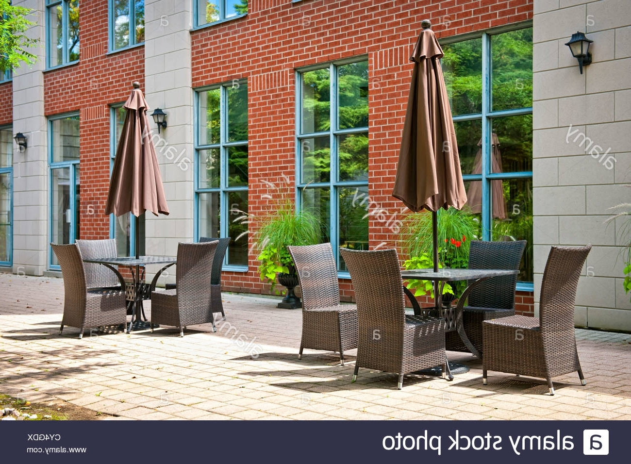 Upscale Patio Umbrellas For Well Known Patio Furniture With Umbrellas On Stone Patio Near Upscale Condo (Gallery 20 of 20)