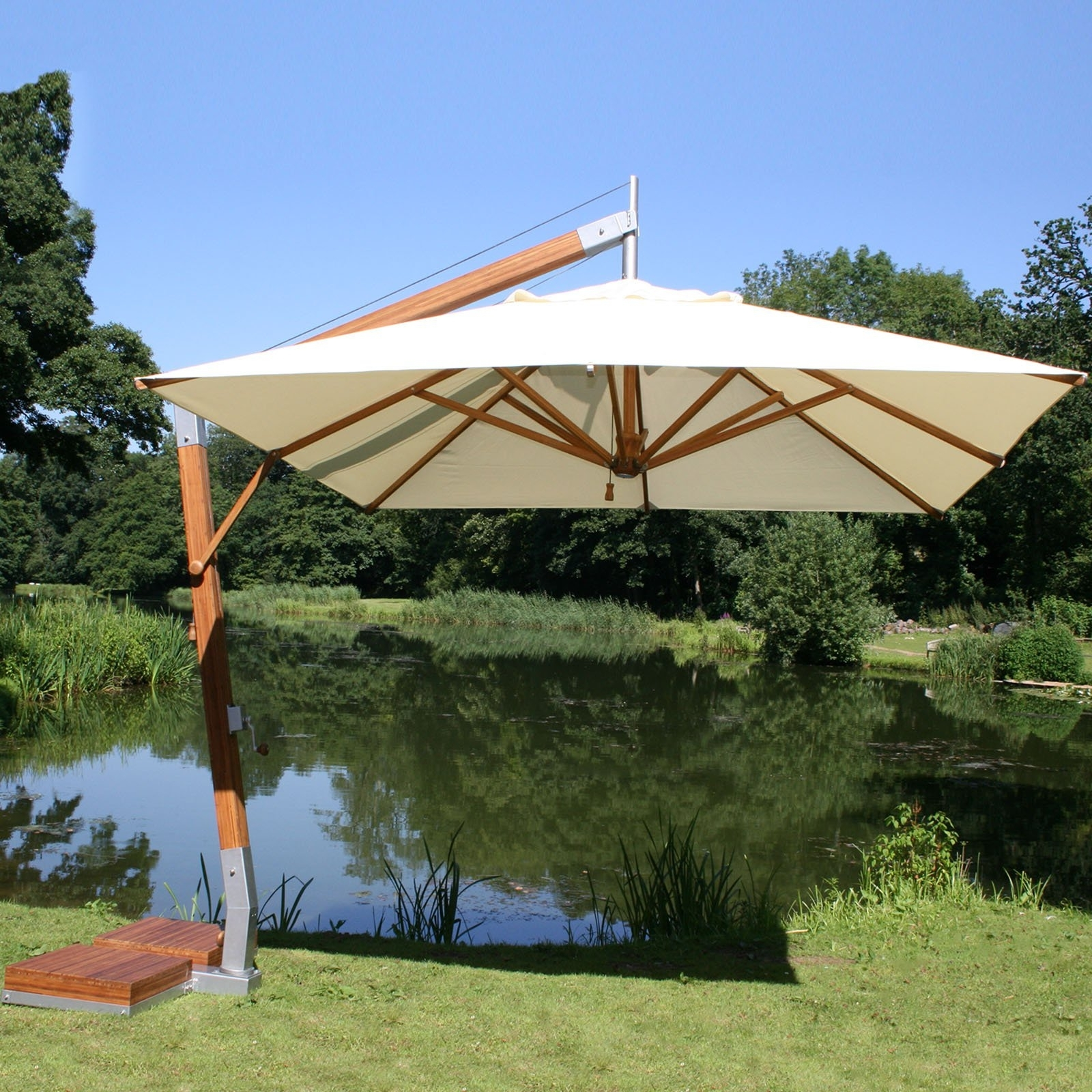 Well Known Furniture: White Offset Patio Umbrellas With Bamboo At Hayneedle Within Offset Patio Umbrellas With Base (View 15 of 20)