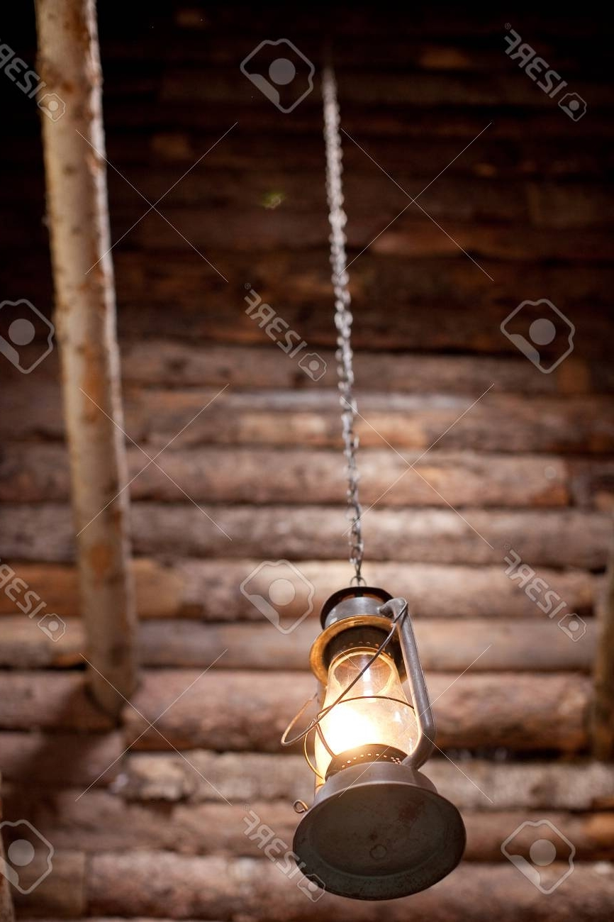 2018 Outdoor Hanging Oil Lanterns Within Hanging Lantern Outside Of Wood Cabin Stock Photo, Picture And (View 8 of 20)