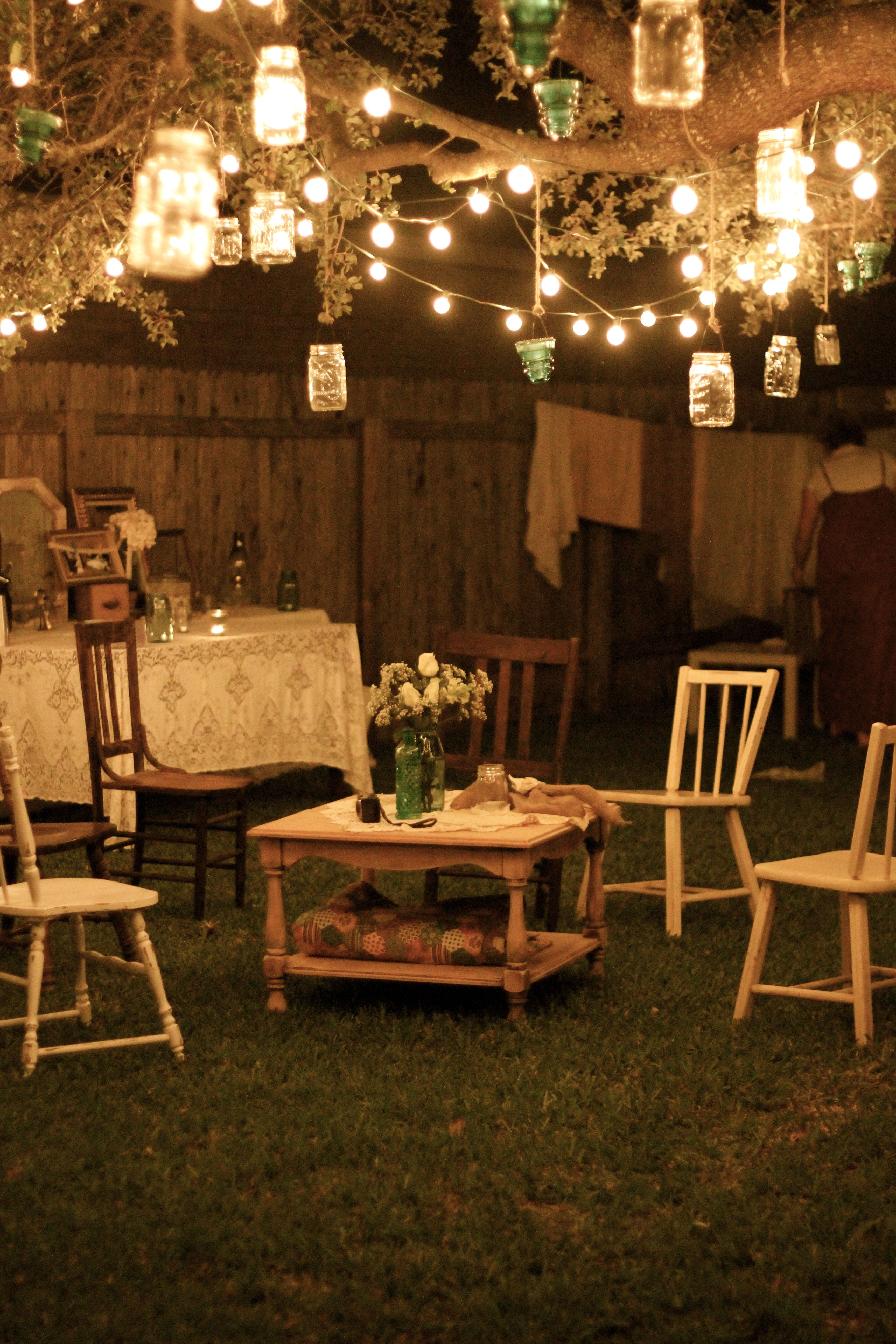 Garden Party At Night; Lanterns Hang From Tree Branches, And Rustic Inside Most Up To Date Outdoor Lanterns For Parties (View 8 of 20)