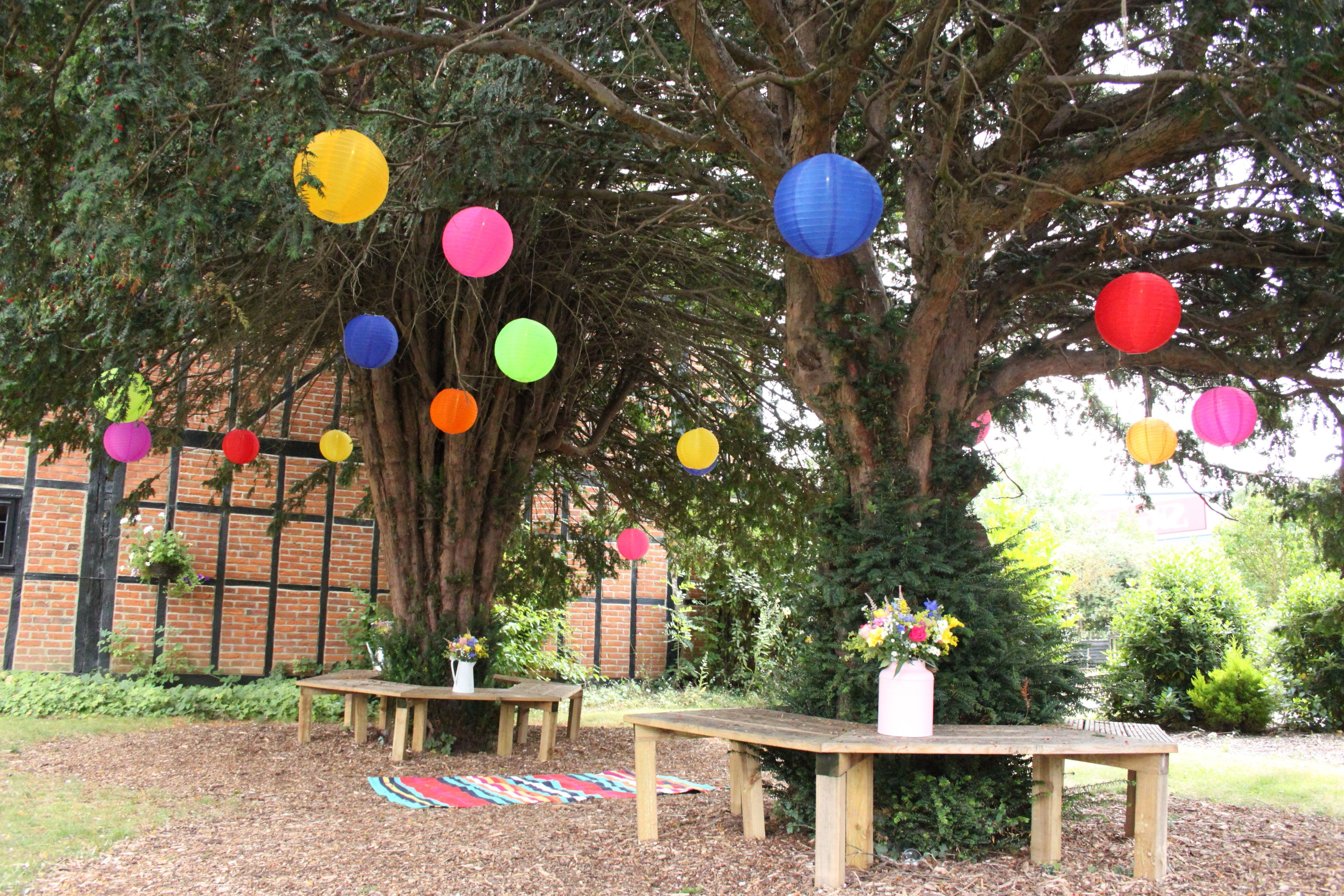 Most Up To Date Mad Hatters Outdoor Coloured Nylon Lanterns Hanging Randomly In The Throughout Outdoor Nylon Lanterns (View 5 of 20)