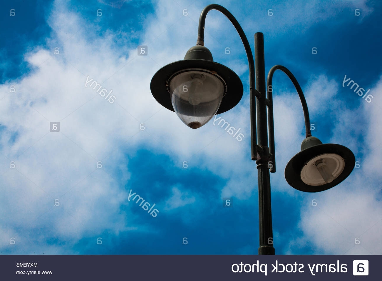 Most Up To Date Outdoor Cast Iron Lanterns With Light Post With Two Bulbs And Blue Cloudy Sky Background (View 18 of 20)