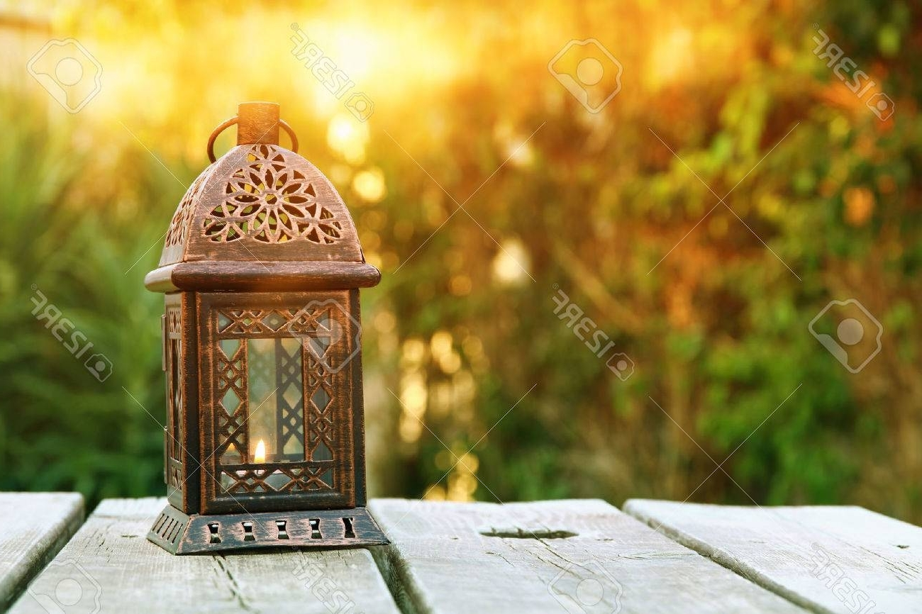 Outdoor Oriental Lanterns Intended For Widely Used Vintage Oriental Lantern Over Wooden Table Outdoors In The Garden (Gallery 13 of 20)