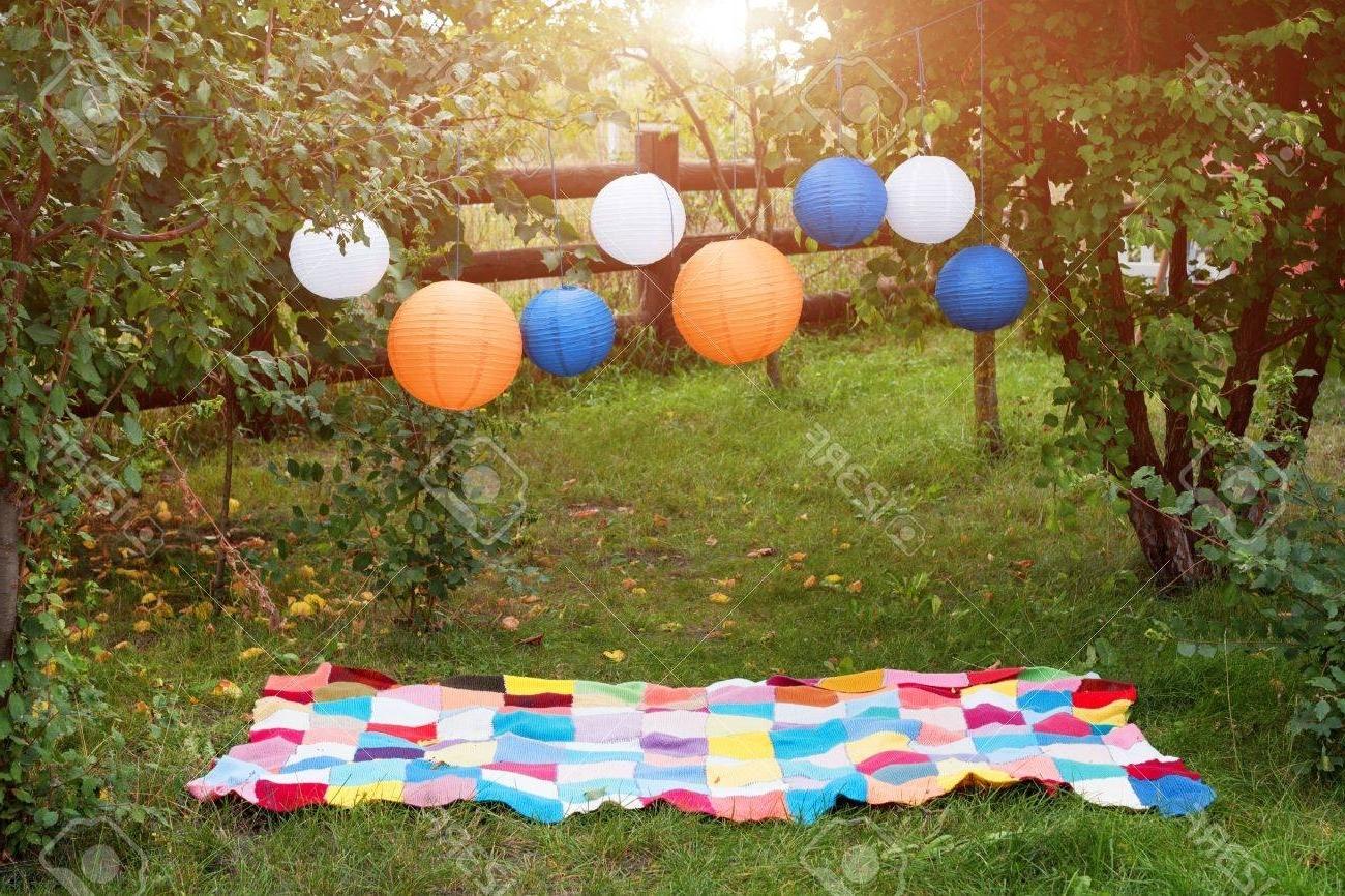 Outdoor Paper Lanterns Regarding Famous Picnic Setting Outdoors With Plaid And Paper Lanterns (View 13 of 20)