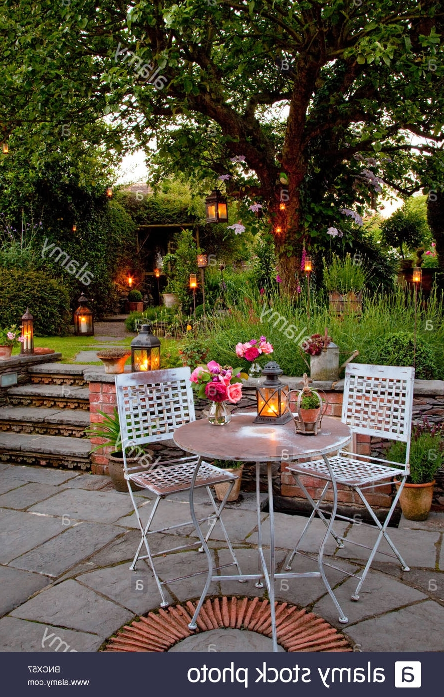 Outdoor Table Lanterns Within Favorite Metal Table And Chairs On Patio With Candles And Lanterns In Garden (View 19 of 20)