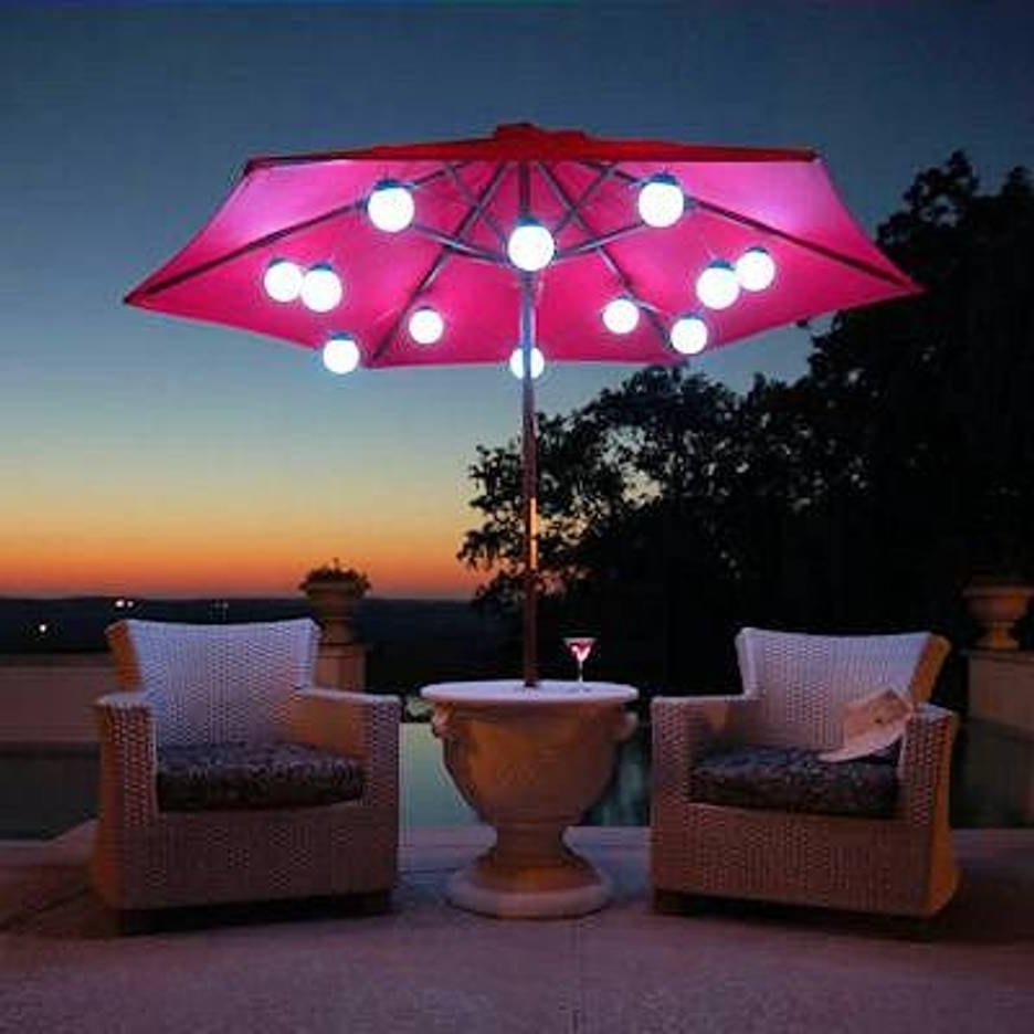 Outdoor Umbrella Lanterns Within Newest Patio Umbrella Marquee Lights White Wicker Chair Scene At Night (View 14 of 20)