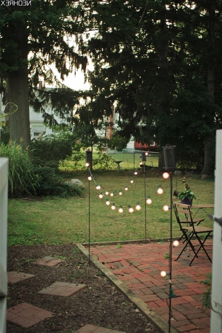 Tiki Torches And Solar Lights Border Patio Area (View 9 of 20)