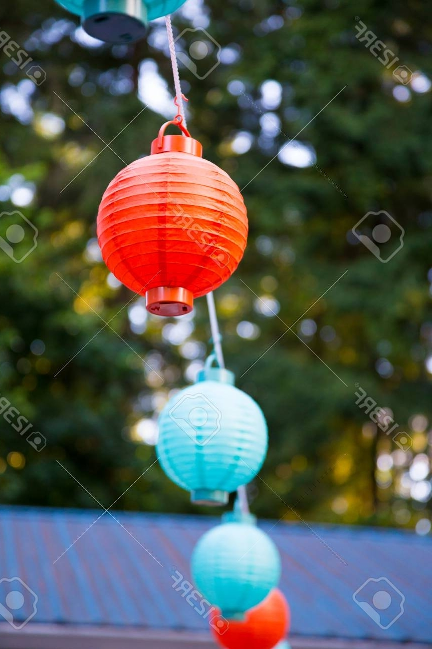 Well Liked Outdoor Paper Lanterns For Red And Blue Paper Lanterns Hung Up High For An Outdoor Wedding (View 8 of 20)