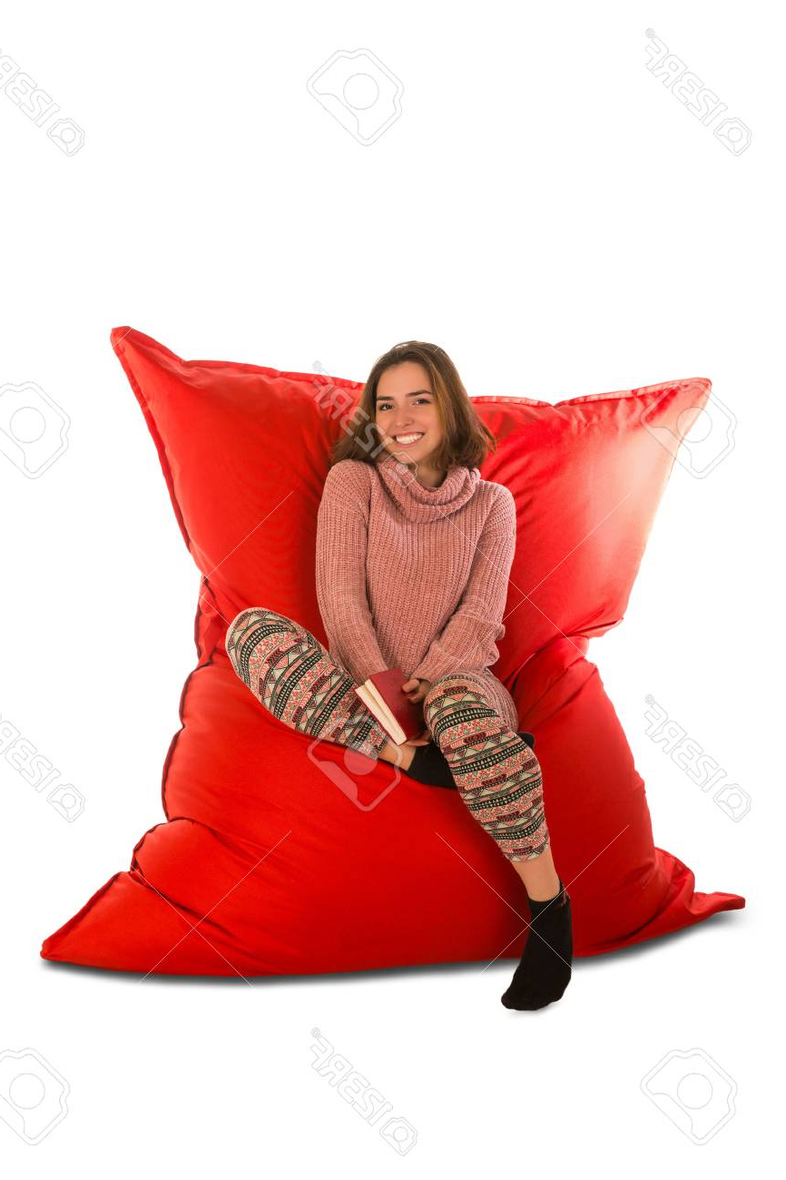 Bean Bag Sofa Chairs Intended For Widely Used Smiling Young Woman Sitting On Red Beanbag Sofa Chair For Living (View 11 of 20)