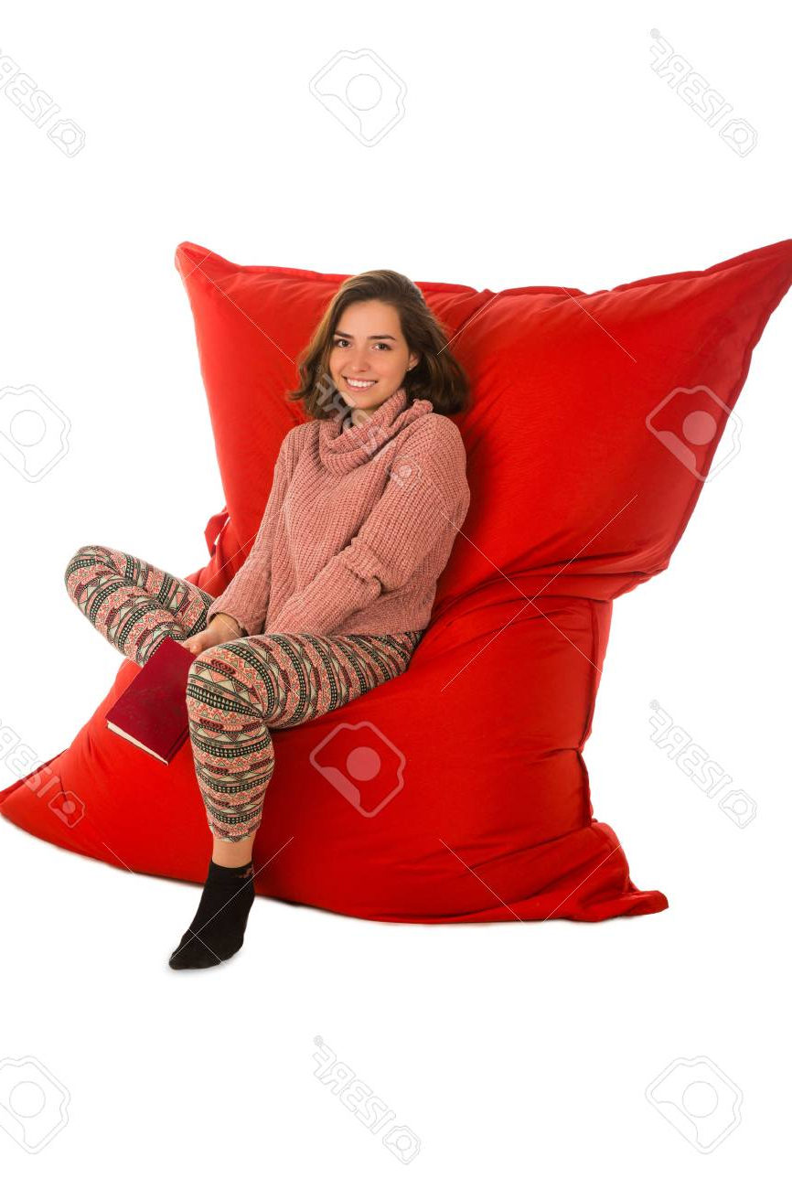 Newest Bean Bag Sofa Chairs Intended For Cute Young Woman Sitting On Red Beanbag Sofa Chair For Living (View 14 of 20)