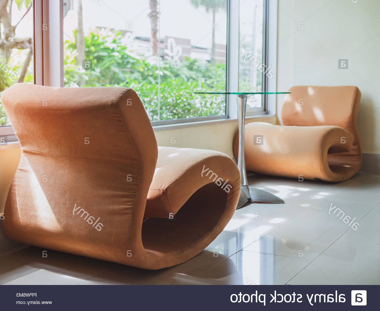 Popular Orange Sofa Chairs With Regard To Orange Sofa Chairs And Glass Table In Waiting Room Near The Window (View 20 of 20)