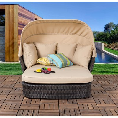Most Recent Behling Canopy Patio Daybeds With Cushions With Regard To Bay Isle Home Tolbert Wicker Patio Daybed With Ottoman (View 13 of 20)