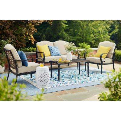 Most Up To Date Corentin Patio Sofas Regarding Laurel Oaks 4 Piece Brown Steel Outdoor Patio Conversation Seating Set With Standard Putty Tan Cushions (View 12 of 20)