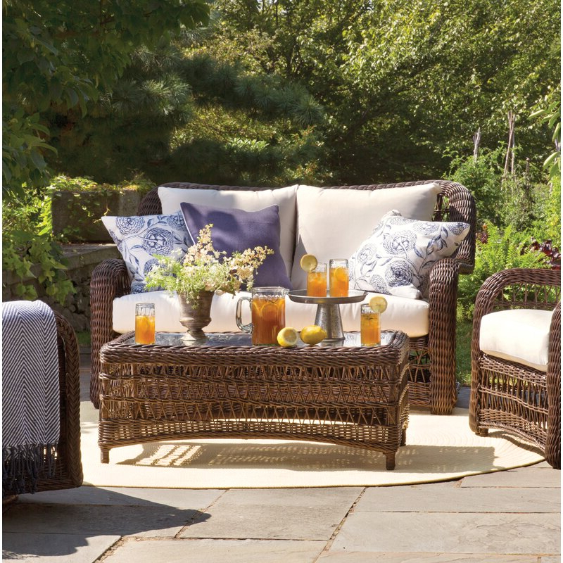 Most Up To Date Karan Wicker Patio Loveseats Intended For Elyse Patio Loveseat With Sunbrella Cushions (View 9 of 20)