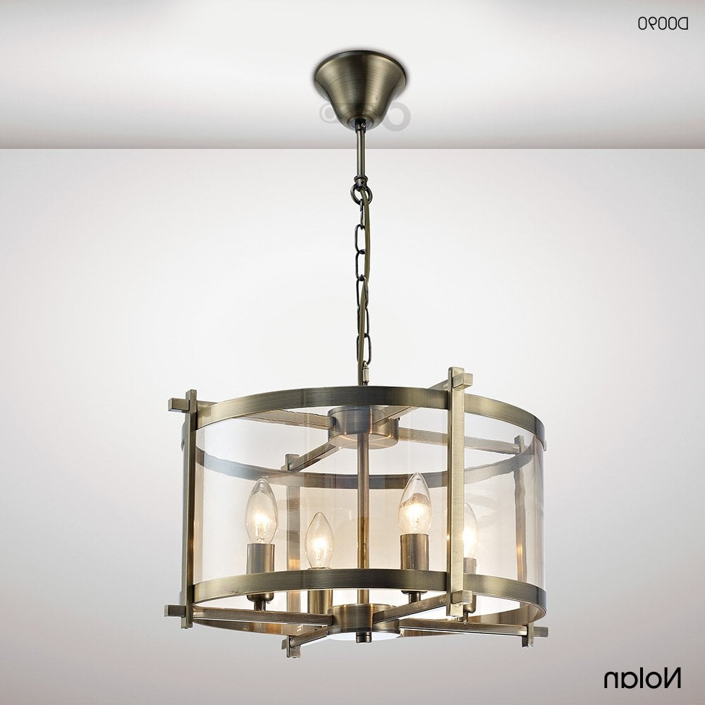 Nolan 1 Light Lantern Chandeliers Throughout Most Recently Released Nolan Lantern 4 Light Medium Ceiling Pendant In Antique Brass Finish With  Amber Glass (View 14 of 20)