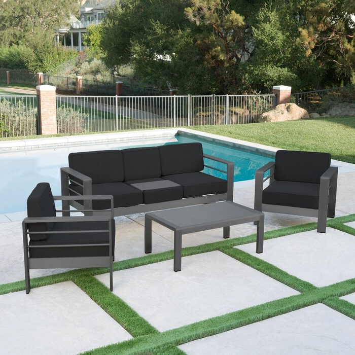 Royalston Patio Sofas With Cushions Intended For Most Popular Royalston 4 Piece Sofa Seating Group With Cushions (View 18 of 20)