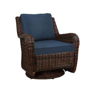 Well Known Cambridge Brown Wicker Swivel Outdoor Rocking Chair With Blue Cushions For Corentin Patio Sofas (View 18 of 20)