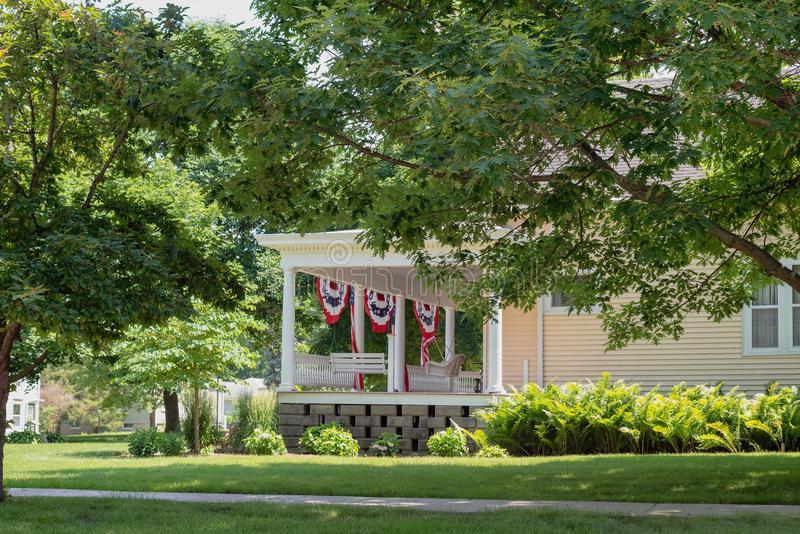 American Flag Porch Swings Throughout Well Known Charming Front Porch Decorated With American Flags For (View 13 of 20)