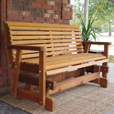 Fashionable Cedar Colonial Style Glider Benches Throughout Millwood Pines Jessica Cedar Glider Bench Finish: Stained (View 7 of 20)