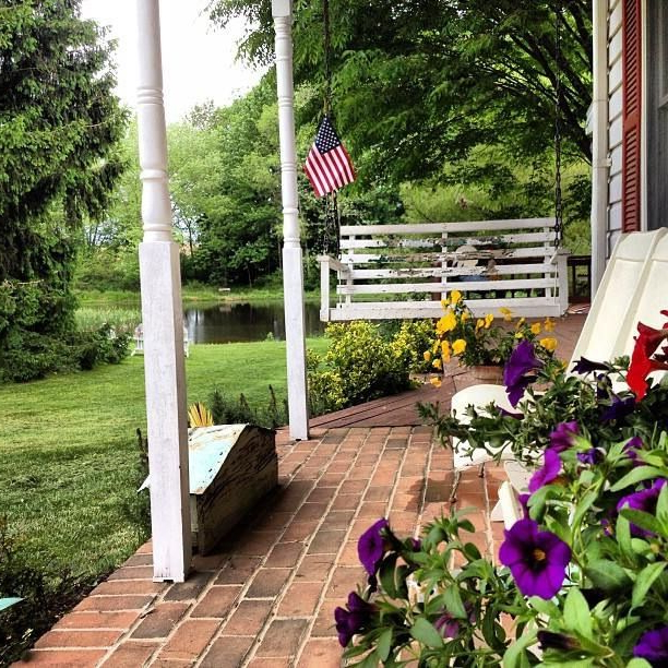 Preferred Vintage Wooden Porch Swing And American Flag At Pinky Swear In American Flag Porch Swings (View 15 of 20)