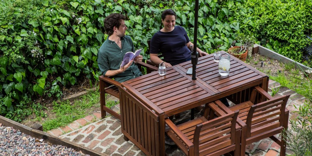 Well Liked 2 Person Light Teak Oil Wood Outdoor Swings Throughout How To Buy Patio Furniture (and Sets We Like For Under $ (View 10 of 20)