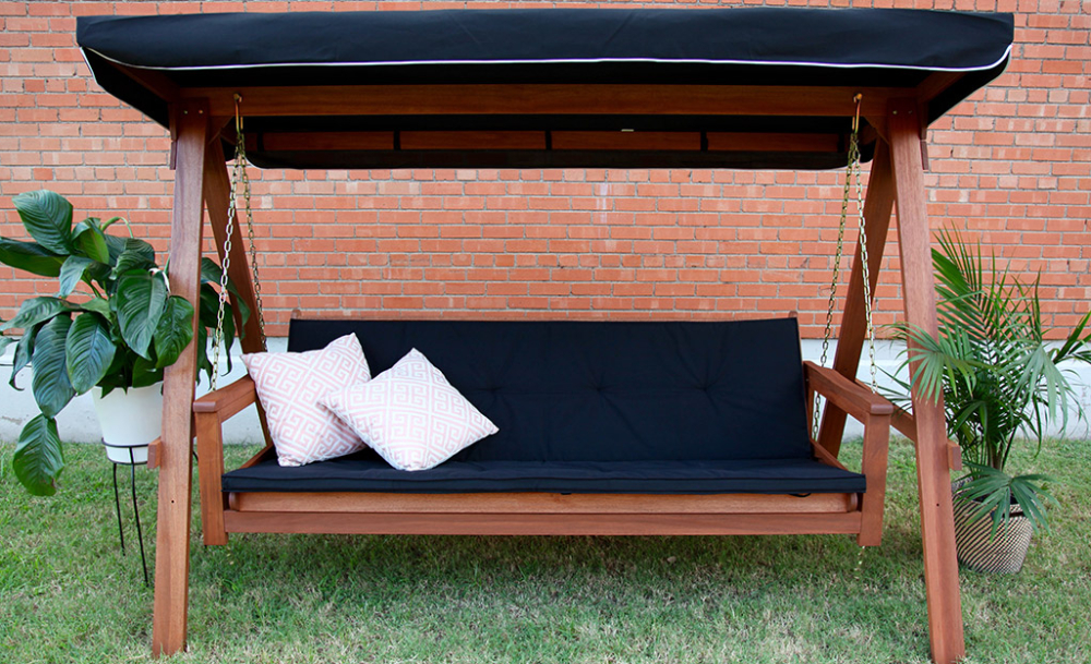 Fashionable A Freestanding Wood Swing With Black Cushion (View 20 of 20)