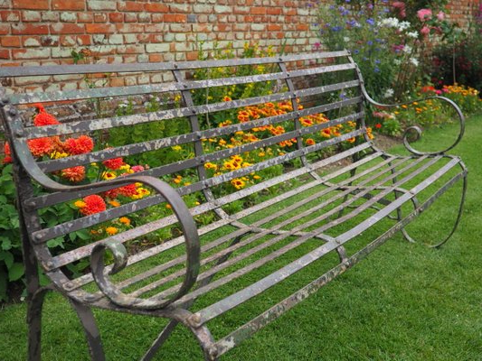 Most Up To Date Antique Wrought Iron 4 Seater Garden Bench Pertaining To Blooming Iron Garden Benches (View 18 of 20)