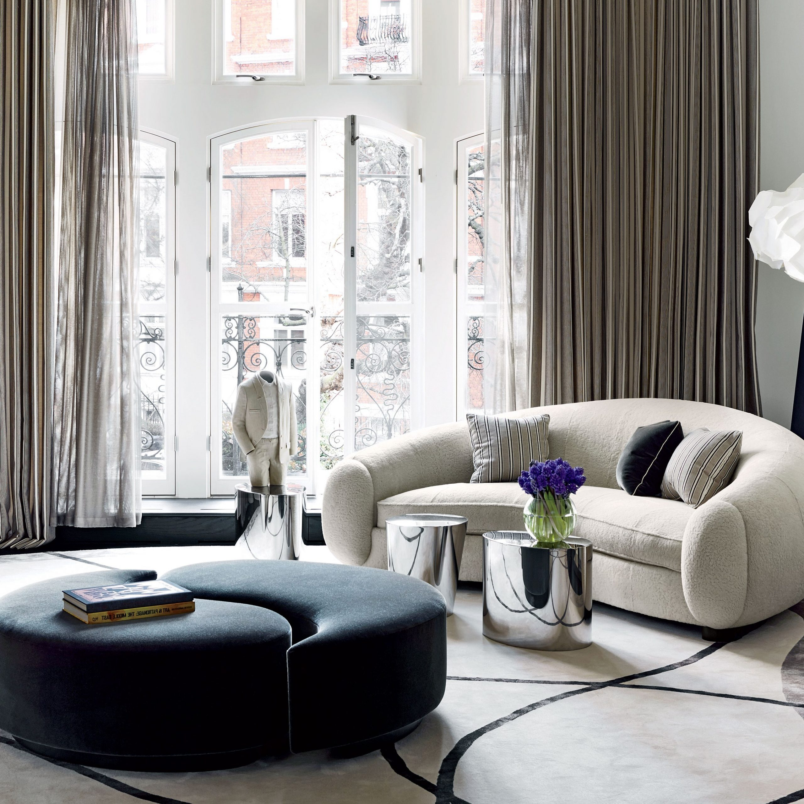 Most Current Starks Tufted Fabric Chesterfield Chair And Ottoman Sets Throughout How To Incorporate Ottomans Into Your Living Room Decor (View 12 of 20)